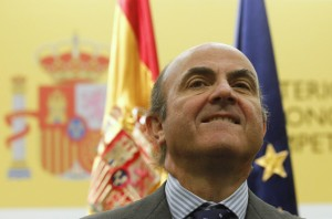 Spain's Economy Minister de Guindos gestures during the swearing-in ceremony of his economic team at the Economy Ministry in Madrid
