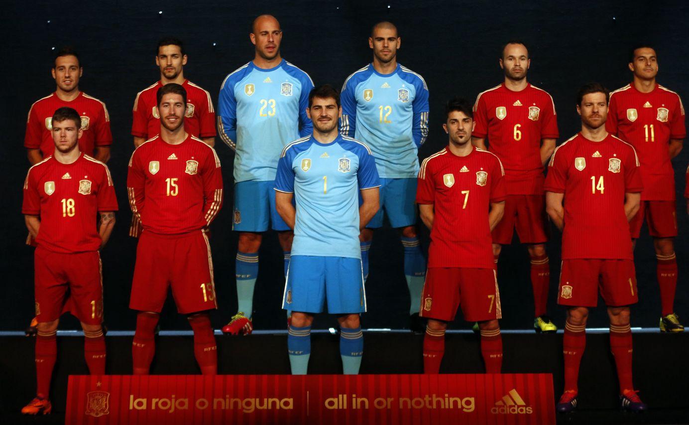 Spain's national soccer team players wearing new Spanish kit for the upcoming 2014 World Cup stand on the stage during a presentation ceremony in Madrid